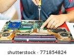 engineer hands repairs laptop... | Shutterstock . vector #771854824