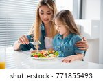 pretty asian girl is eating... | Shutterstock . vector #771855493