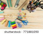 frame with school supplies.... | Shutterstock . vector #771881050