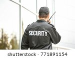 male security guard using... | Shutterstock . vector #771891154