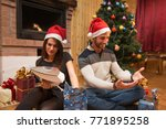 young couple opening christmas... | Shutterstock . vector #771895258