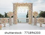 elegant wedding arch with fresh ...