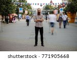 young bearded man standing... | Shutterstock . vector #771905668