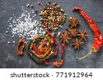Small photo of Spices on the stone black background. Condiments on a dark table. Seasoning for cooking. Seasoning mix.