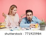Small photo of Puzzled female secretary asks friend to help her with preapring business report, looks at sleepy partner who is exhausted and can`t work anymore, has tired expression. People and weariness concept