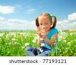 Little Girl Is Smelling Flower...