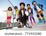 girl in rollerblades playing... | Shutterstock . vector #771933280