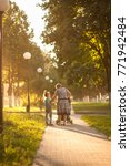 grandmother walking with... | Shutterstock . vector #771942484
