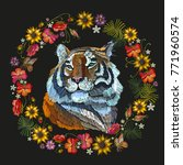 embroidery tiger and flowers.... | Shutterstock .eps vector #771960574