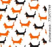 polygonal dogs seamless pattern.... | Shutterstock .eps vector #771977749