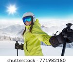 happy young woman skier... | Shutterstock . vector #771982180