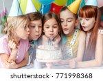 festive children in party caps  ... | Shutterstock . vector #771998368