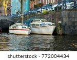 tourist boats in amsterdam... | Shutterstock . vector #772004434