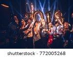 group of friends celebrating... | Shutterstock . vector #772005268