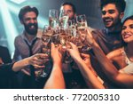 group of friends toasting with... | Shutterstock . vector #772005310