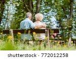 rear view of a romantic elderly ... | Shutterstock . vector #772012258