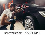 car detailing   the man holds... | Shutterstock . vector #772014358