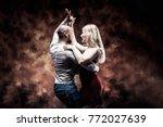 Young Couple Dances Caribbean...