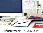office table with blank notepad ... | Shutterstock . vector #772063549
