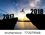 man jumping from 2017 to 2018 | Shutterstock . vector #772079068