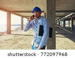 male architect pointing at...   Shutterstock . vector #772097968