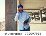 male architect pointing at...   Shutterstock . vector #772097998