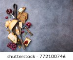 Assorted Cheeses On Wooden...