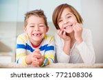 cute little siblings making... | Shutterstock . vector #772108306