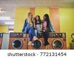 three young girlfriends sitting ... | Shutterstock . vector #772131454