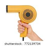 hand holding an old hairdryer... | Shutterstock . vector #772139734