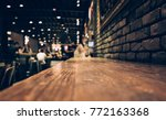 blur of wood bar table in night ... | Shutterstock . vector #772163368