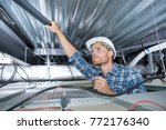 construction worker removing... | Shutterstock . vector #772176340