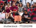 activists wearing t shirts... | Shutterstock . vector #772202398