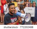 an activist wearing a t shirt... | Shutterstock . vector #772202488