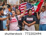 """Small photo of Activists wearing a t-shirt reading """"Undocumented and Unafraid"""" an """"Latina Power"""" at a rally to protest president Donald Trump's decision to end DACA Downtown Portland, OR, on September 5th, 2017."""