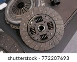 Small photo of View on new clean car truck clutch component part detail. Car clutch disc disk parts details components for maintenance repair Car clutch disc spare parts. Truck clutch disc Car parts component detail