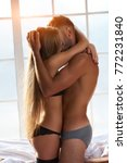 couple in underwear hugging.... | Shutterstock . vector #772231840
