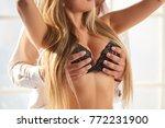 hands of man touching boobs....   Shutterstock . vector #772231900