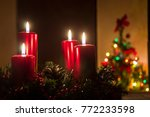 four red candles burning on... | Shutterstock . vector #772233598