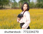 asian lady attractive holding... | Shutterstock . vector #772234270