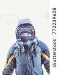 boy bundled for the cold... | Shutterstock . vector #772239628