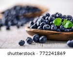 blueberry on white wooden table ... | Shutterstock . vector #772241869