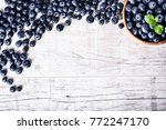 blueberries on white table.... | Shutterstock . vector #772247170