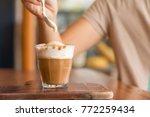 latte macchiato coffee on... | Shutterstock . vector #772259434