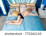 man sleep in blue bed. macho... | Shutterstock . vector #772262110
