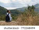 back view of young girl with... | Shutterstock . vector #772268494