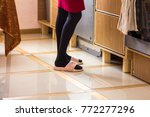 feet of a house wife in pink... | Shutterstock . vector #772277296