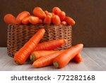 a lot of carrots in a wicker... | Shutterstock . vector #772282168