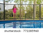 pool safety   young girl... | Shutterstock . vector #772285960