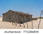 Small photo of African country house made of sticks in the Namibe Desert. Angola, Africa